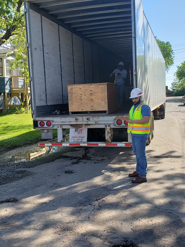 Rampreet Singh, general supply specialist, loads excess equipment from Detroit District area office's onto a flat-bed truck headed to a UNICOR facility in Kansas for recycling.