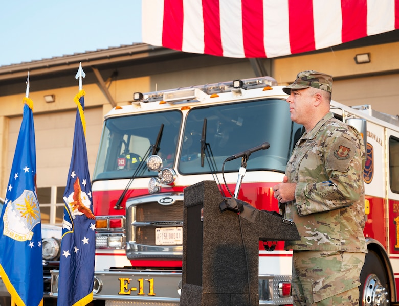 Col. Patrick Miller, 88th Air Base Wing and installation commander, delivers remarks during the 9/11 commemoration ceremony Sept. 10, 2021, in front of the main firehouse  at Wright-Patterson Air Force Base, Ohio. Miller praised heroics of the first responders that day and how they continue to inspire. (U.S. Air Force photo by R.J. Oriez)