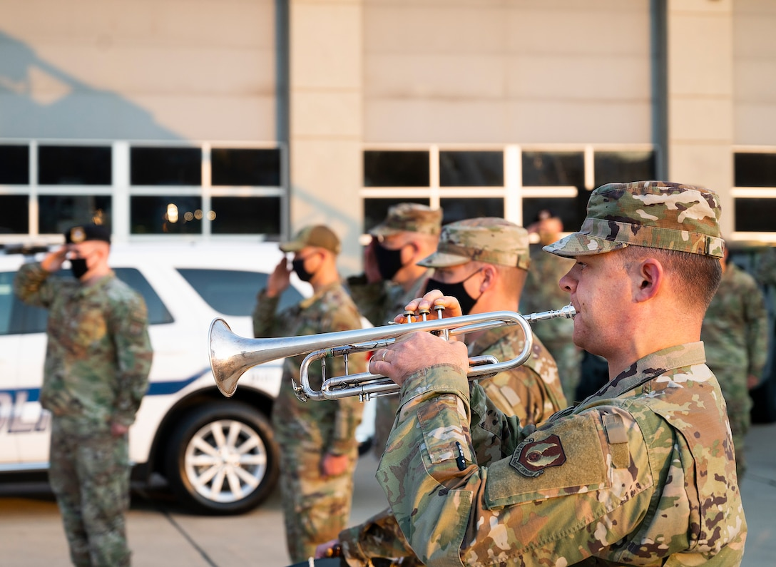 Airman 1st Class James Nufer, Air Force Band of Flight, plays taps Sept. 10, 2021, during the Wright-Patterson Air Force Base, Ohio, ceremony commemorating the 20th anniversary of the 9/11 attacks. COVID-19 restrictions limited the number of event attendees, but it was later streamed for those who wanted to see it. (U.S. Air Force photo by R.J. Oriez)