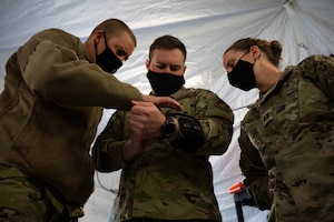 U.S. Airmen assigned to the 354th and 673rd Medical Group participate in a Capabilities-Based Assessment (CBA) at the Yukon Training Area, Sept. 14, 2021.