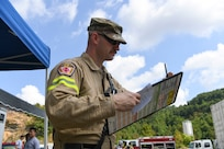 Technical Sgt. Robert Laidlow, 167th Fire and Emergency Services, monitors and keeps account of the firefighters assigned to his team during collapsed structure training as part of Exercise Vigilant Guard 2021 Aug. 27, 2021.