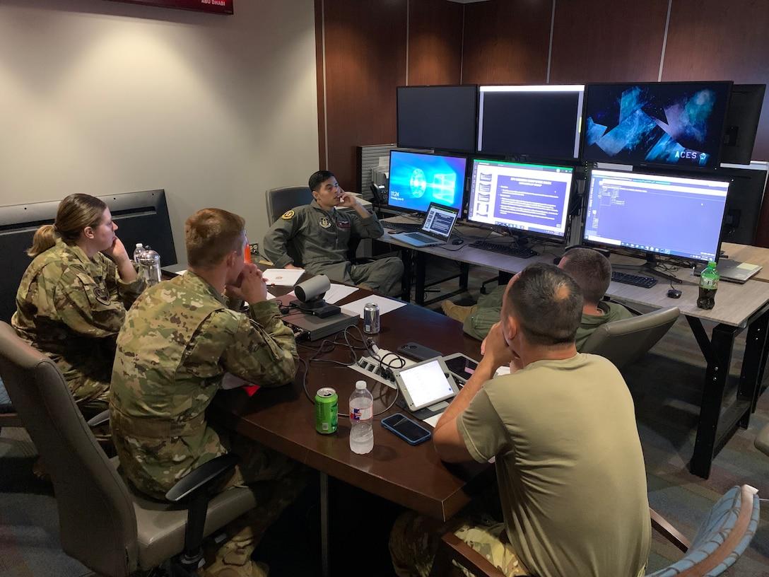 Airmen in a briefing room.