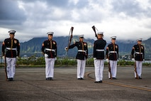 """Marines with the Silent Drill Platoon execute their """"rifle inspection"""" sequence on the flight line at Marine Corps Base Hawaii, Sept. 10, 2021."""