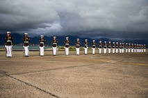 """Marines with the Silent Drill Platoon execute their """"long line"""" sequence on the flight line at Marine Corps Base Hawaii, Sept. 10, 2021."""
