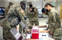 Lt. Gen. Theodore Martin (center), commander of the U.S. Army Combined Arms Center, or CAC, takes a photo of 68W Combat Medic's training during a culminating Field Training Exercise at the Soldier Medic Training Site, Medical Education and Training Campus, Joint Base San Antonio-Camp Bullis, Sept. 10.