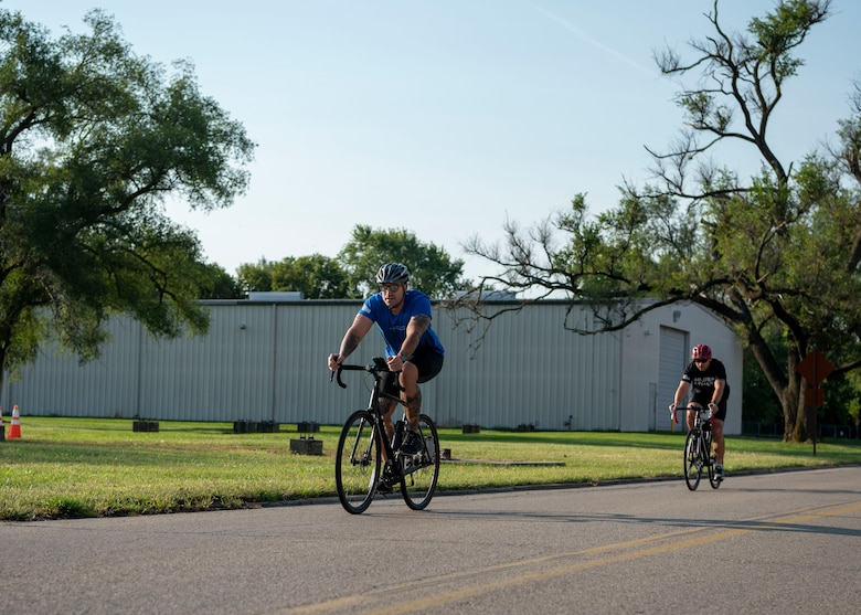 Two sprint triathlon competitors participate in a 20K bike ride on Wright-Patterson Air Force Base, Ohio, Sept. 11. Participants completed a 750-yard swim, 20K bike ride and a 5K run. (U.S. Air Force photo by Staff Sgt. Mikaley Kline)