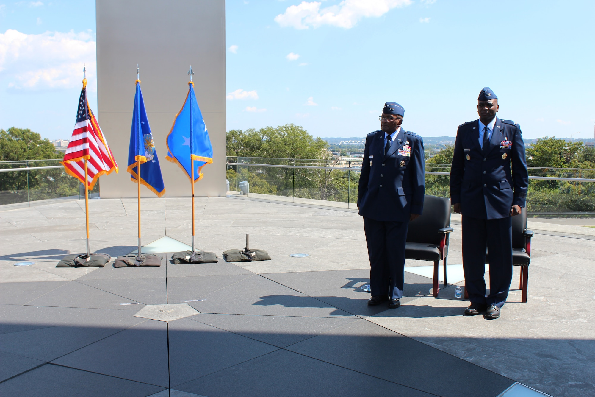 Retired Maj. Gen. Alfred K. Flowers, Sr. (left), the longest-serving Airman, stands next to his son, Brig. Gen. Alfred K. Flowers, Jr., Air Force Medical Service Manpower, Personnel and Resources director, during Flowers, Jr.'s promotion ceremony at the Air Force Memorial in Arlington, Va., Sept. 7, 2021.