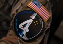 U.S. Space Force 1st Lt. Stephen Pitre, 1st Range Operations Squadron range engineer, wears an Inspiration4 patch on his uniform in support of the Inspiration4 launch Sept. 15, 2021, inside the Morrell Operations Center at Cape Canaveral Space Force Station, Florida. Pitre was part of a team of Guardians, Department of Defense civilians and U.S. Coast Guardsmen who supported the launch. The MOC supports every space launch from CCSFS and Kennedy Space Center. (U.S. Space Force photo by Tech. Sgt. James Hodgman)