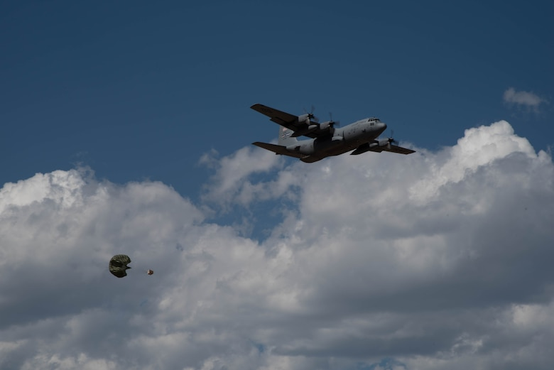 A C-130H Hercules aircraft with the 94th Airlift Wing, Dobbins Air Reserve Base, Georgia, drops cargo Sept. 14, 2021, at the Rifle Garfield County Airport, Colorado. Active-duty Air Force, Air National Guard and Reserve Citizen Airmen gathered at airfield to take part in the 22nd Air Force's flagship exercise Rally in the Rockies Sept. 12-17, 2021. The exercise is designed to develop Airmen for combat operations by challenging them with realistic scenarios that support a full spectrum of operations during military actions, operations or hostile environments.