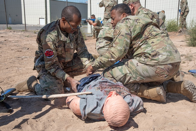 Tech. Sgt. Melvin Tucker, 403rd Logistics Readiness Squadron, Keesler Air Force Base, Mississippi, and Senior Airman Raymond Thomas, 910th LRS, Youngstown Air Reserve Base, Ohio, get hands on Tactical Combat Casualty Care training Sept. 15, 2021, at Rifle Garfield County Airport, Colorado during 22nd Air Force's flagship exercise Rally in the Rockies Sept. 12-17, 2021. The exericses is aimed at developing Airmen for combat operations. More than 100 Airmen were at Rifle Garfield County Airport, Rifle, Colorado taking part in the air operations portion of the exercise and honing expeditionary skill sets by taking part in Multi-Capable Airmen training where they learned skills from various Air Force jobs to include Wet-Wing Defueling and Tactical Combat Casualty Care. TCCC focuses on care under fire, tactical field care and tactical evacuation care.