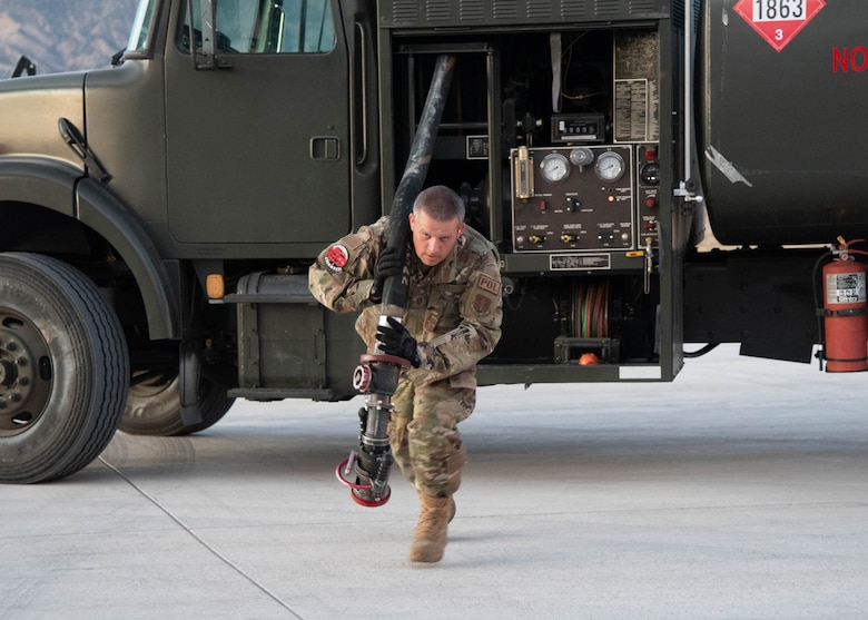 Master Sgt. David Swaney, 153rd Logisitics Readiness Squadron, Wyoming Air National Guard, drags a fuel hose to the aircraft as part of wet-wing defuel training Sept. 13, 2021. Fellow fuels technicans from the active-duty Air Force, Air National Guard and Air Force reservists trained on wet-wing defueling to offload fuel from an aircraft to a refueler truck. The Airmen gathered at Rifle-Garfield County Airport, Rifle, Colorado, to take part in the 22nd Air Force's flagship exercise Rally in the Rockies Sept. 12-17, 2021. The exercise is designed to develop Airmen for combat operations by challenging them with realistic scenarios that support a full spectrum of operations during military actions, operations or hostile environments.