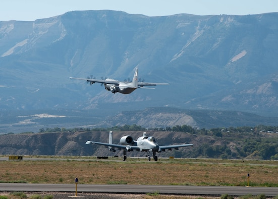 A C-130J Super Hercules flown by the 815th Airlift Squadron, Keesler Air Force Base, Mississippi, departs while an A-10 Thunderbolt II aircraft flown by the 354th Fighter Squadron, Davis-Monthan Air Force Base, Arizona, arrives at Rifle Garfiield County Airport, Colorado, Sept. 15, 2021. Active-duty Air Force, Air National Guard and Reserve Citizen Airmen gathered at the airfield to take part in the 22nd Air Force's flagship exercise Rally in the Rockies Sept. 12-17, 2021. The exercise is designed to develop Airmen for combat operations by challenging them with realistic scenarios that support a full spectrum of operations during military actions, operations or hostile environments.
