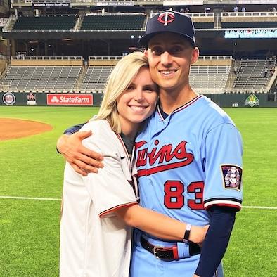 Capt. Griffin Jax, Minnesota Twins pitcher, hugs his wife, Savannah, at his Major League Baseball debut in Kansas City, Missouri, June 5, 2021.