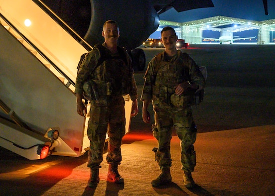 U.S. Air Force Staff Sgt. Harold S. Balcom III (left) and U.S. Staff Sgt. Jacob T. Crabtree (right), air traffic control liaisons assigned to the 378th Expeditionary Operations Support Squadron, pose for a photo on the flightline at Prince Sultan Air Base, Kingdom of Saudi Arabia, just after returning from a forward deployment to Afghanistan, Aug. 31, 2021. The two Airmen joined coalition forces in providing air traffic control support for non-combatant evacuation operations at Hamid Karzai International Airport, Kabul, controlling more than 1,000 aircraft over a 12-day period and contributing to the evacuation of over 120,000 personnel. (U.S. Air Force photo by Senior Airman Samuel Earick).