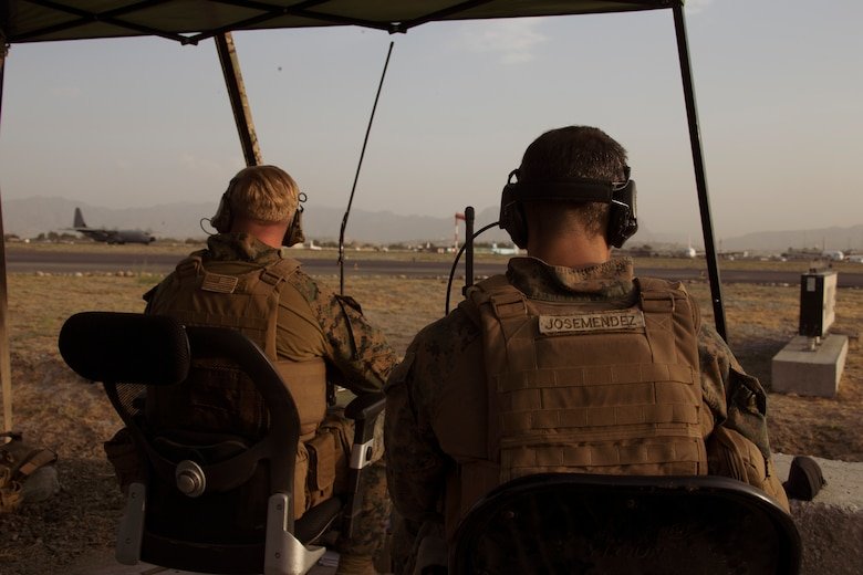 Marines assigned to the 24th Marine Expeditionary Unit monitor the air traffic control center at Hamid Karzai International Airport, Afghanistan, Aug. 22. U.S. service members are assisting the Department of State with a Non-combatant Evacuation Operation (NEO) in Afghanistan. (U.S. Marine Corps photo by Cpl. Davis Harris)