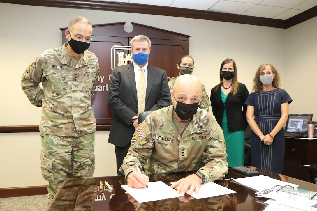 Lt. Gen. Scott A. Spellmon, commanding general, signs the Chief's Report for the San Juan Metro Area Coastal Storm Risk Management (CSRM) Study. The signing of this report marks a crucial milestone and progresses the proposed project to Congress for individual authorization. (USACE photo)