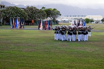 """Marines with the Silent Drill Platoon execute their """"bursting bomb"""" sequence during the Patriot's Day Remembrance Ceremony at Marine Corps Base Hawaii, Sept. 11, 2021."""