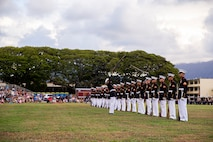 """Marines with the Silent Drill Platoon execute their """"rifle inspection"""" sequence during the Patriot's Day Remembrance Ceremony at Marine Corps Base Hawaii, Sept. 11, 2021."""