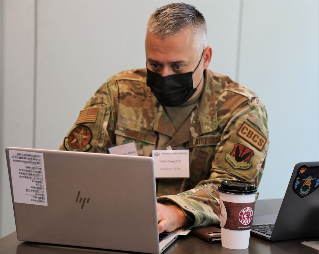 U.S. Air Force Master Sgt. Patrick Shirley, a cybersecurity noncommissioned officer with the 283rd Combat Communications Squadron, 116th Air Control Wing, Georgia Air National Guard, monitors cyber activity during exercise Cyber Dawg 21 Sept. 14, 2021, at the Georgia Cyber Center in Augusta, Georgia. Cyber Dawg 21 participants learned how to expose and correct weaknesses in cyber operations policies and procedures.