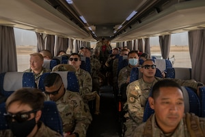 U.S. Airmen with the 332nd Air Expeditionary Wing and the 557th Expeditionary Red Horse Squadron return from Al Udeid Air Base, Qatar, after a forward deployment