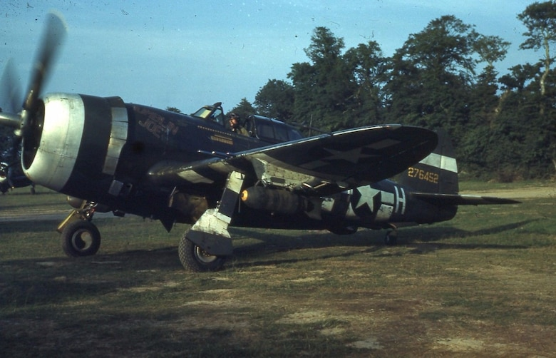 """""""MUMBLIN JOE,"""" a Republic P-47D-20-RE Thunderbolt, serial number 42-76452, was assigned to the 371st Fighter Group's 405th Fighter Squadron (squadron code 8N). The aircraft bore the name of pilot Lt. Arthur W. """"Bud"""" Holderness Jr., with the individual aircraft letter of """"H"""" aft of the national insignia on the fuselage. It is pictured here with 41 mission symbols, bombed up and headed out for another combat mission, probably from A-6 airfield in France in the summer of 1944, probably with Lt. Holderness as the pilot. Holderness, a 1943 US Military Academy graduate, flew 142 combat missions with the 371st during the war, received the Distinguished Flying Cross, 19 Air Medals, the French Croix de Guerre, and was one of two pilots in his squadron to earn the Lead Crew Combat Pilot patch. He went on to have a long and successful postwar career in the USAF, retiring in 1971 as a brigadier general. (Via Maj Tom Silkowski, 190th Fighter Squadron, Idaho Air National Guard)"""