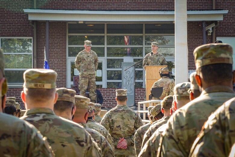 A commander speaks to his troops.