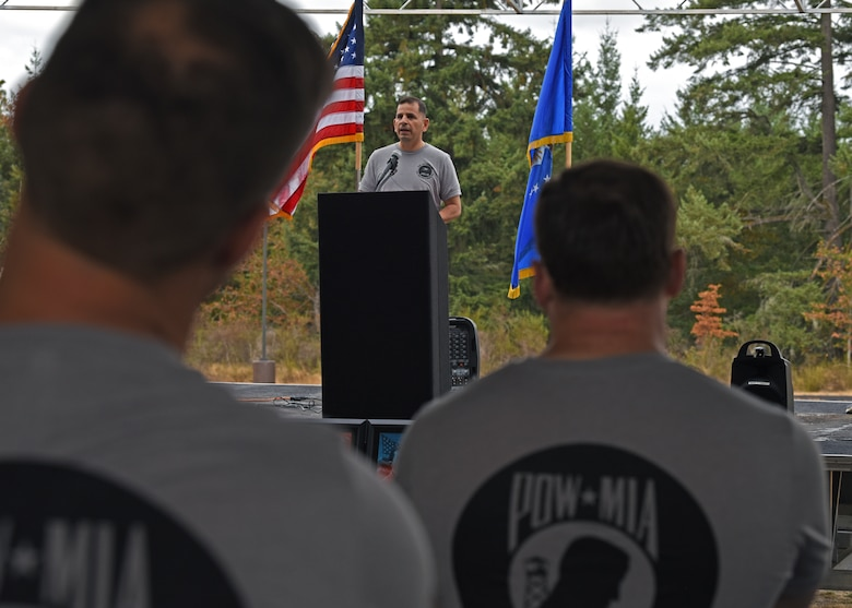 U.S. Air Force Col. Sergio Anaya, 62nd Operations Group commander, gives opening remarks during the 24-hour POW/MIA Remembrance run at Joint Base Lewis-McChord, Washington, Sept. 15, 2021. Team McChord planned several events this week to honor the lives and sacrifices of those men and women who were prisoners of war or missing in action, including a Missing Man Table and Honors Ceremony, a community motorcycle ride and a wreath laying ceremony. (U.S. Air Force photo by Senior Airman Zoe Thacker)