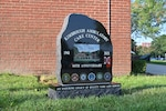A commemorative stone sits near the Pharmacy entrance to Kimbrough Ambulatory Care Center after it was unveiled at the 60th anniversary ceremony held at the facility's main entrance, Sept. 14, 2021.