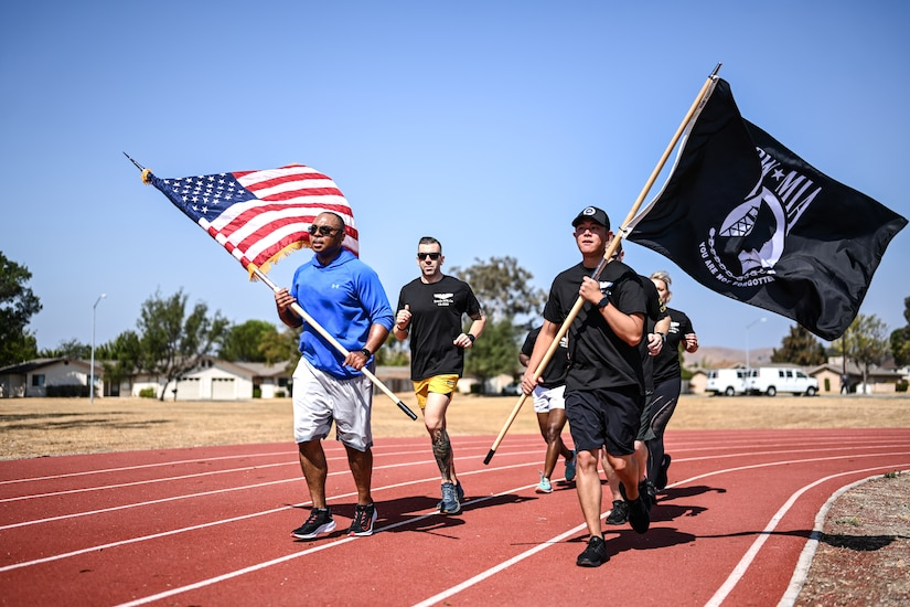 People run with flags.