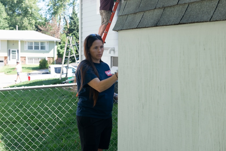 Tia Himes, Nation Park Services Right of Way coordinator, paints a shed during the 2021 Paint-A-Thon, Aug. 21, 2021,