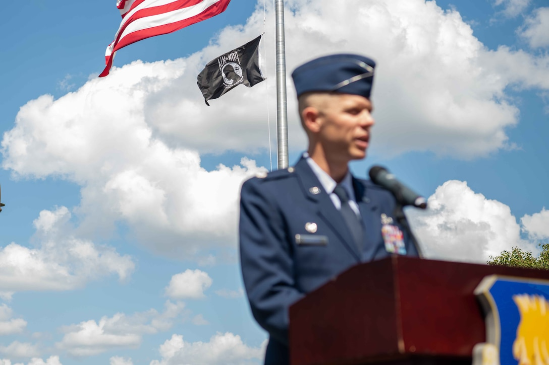 Lt. Col. Jonathan Needham, 22nd Civil Engineer Squadron commander, shares remarks during the Prisoner of War/Missing in Action wreath laying ceremony Sept. 16, 2021, at McConnell. Air Force Base, Kansas. The wreath ceremony has become an official wing ceremony held annually in honor of National POW/MIA Recognition Day. (U.S. Air Force photo by Senior Airman Marc A. Garcia)