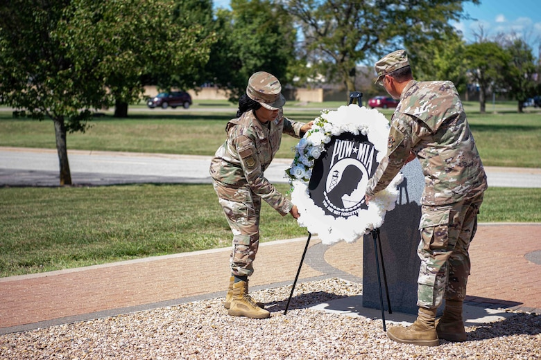 Col. Nate Vogel, 22nd Air Refueling Wing commander, and Chief Master Sgt. Melissa Royster, 22nd ARW command chief, lay a Prisoner of War/Missing in Action wreath during the POW/MIA wreath laying ceremony Sept. 16, 2021, at McConnell Air Force Base, Kansas. McConnell AFB hosts the ceremony to honor the United States' Prisoners of War and those who are still Missing in Action. (U.S. Air Force photo by Senior Airman Marc A. Garcia)