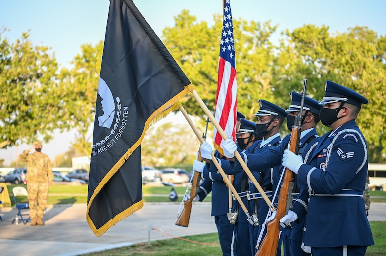 Members of the base honor guard post the colors for the National Anthem during the POW/MIA ceremony Sept. 17, 2021, at Hill Air Force Base, Utah. Former prisoner of war and retired Air Force Capt. William Robinson was the featured speaker. Robinson was a POW for nearly eight years before being released. (U.S. Air Force photo by Cynthia Griggs)