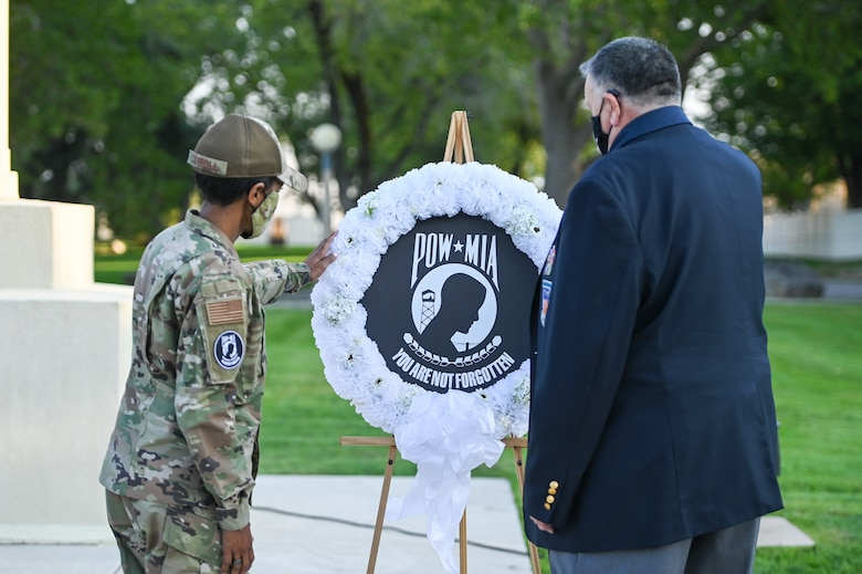 Col. Jenise Carroll, 75th Air Base Wing commander, and former prisoner of war and retired Air Force Capt. William Robinson present the POW/MIA wreath during the POW/MIA ceremony Sept. 17, 2021, at Hill Air Force Base, Utah. Robinson, who was a POW for nearly eight years before being released, was the featured speaker. (U.S. Air Force photo by Cynthia Griggs)