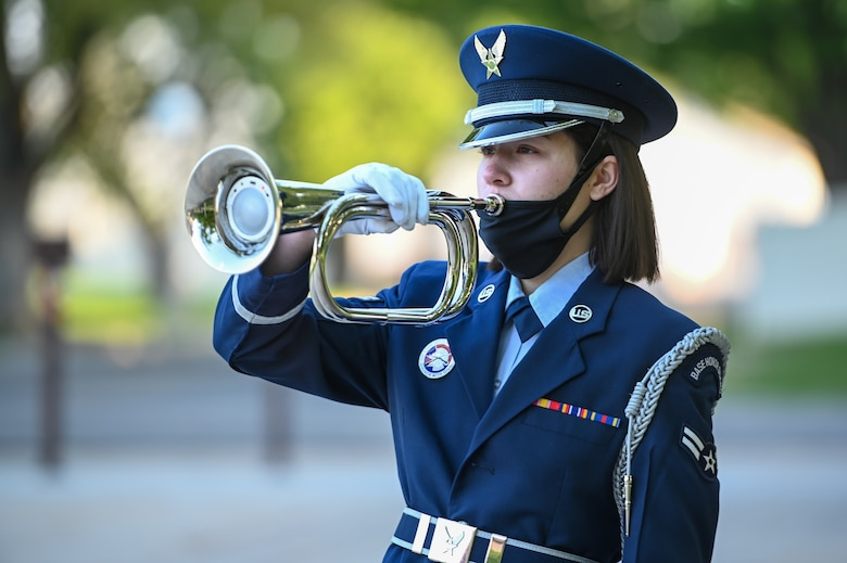 """Airman 1st Class Tori Salem, base honor guard, """"performs"""" taps during the POW/MIA ceremony Sept. 17, 2021, at Hill Air Force Base, Utah. The ceremony served to remember and honor those Americans who were prisoners of war and those who served and never returned home. (U.S. Air Force photo by Cynthia Griggs)"""