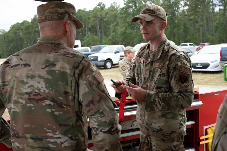 A photo of an Airman briefing another Airman.