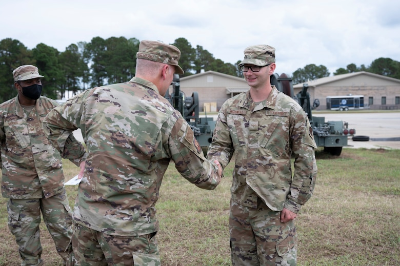 A photo of two Airmen shaking hands.