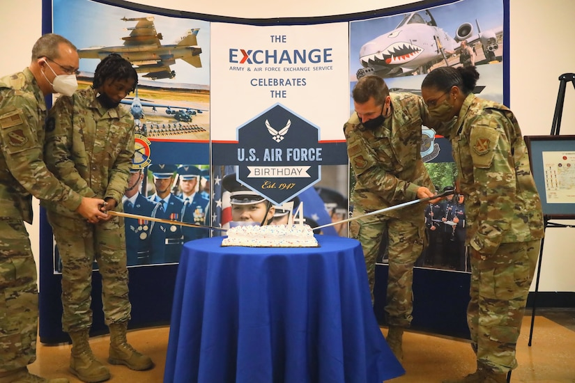 U.S. Air Force Col. Mike Zuhlsdorf, Joint Base Anacostia-Bolling and 11th Wing commander, celebrates the Air Forces 74th birthday with a cake cutting event at Joint Base Anacostia-Bolling, Washington, D.C., Sept. 17, 2021. Col. Zuhlsdorf was joined at the cake cutting event by Chief Master Sgt. Christy Peterson, the oldest Airmen at JBAB Lt. Col. Richard Beyea, senior chaplain and the youngest Airmen A1C London Vaulx, ceremonial guardsmen at JBAB.