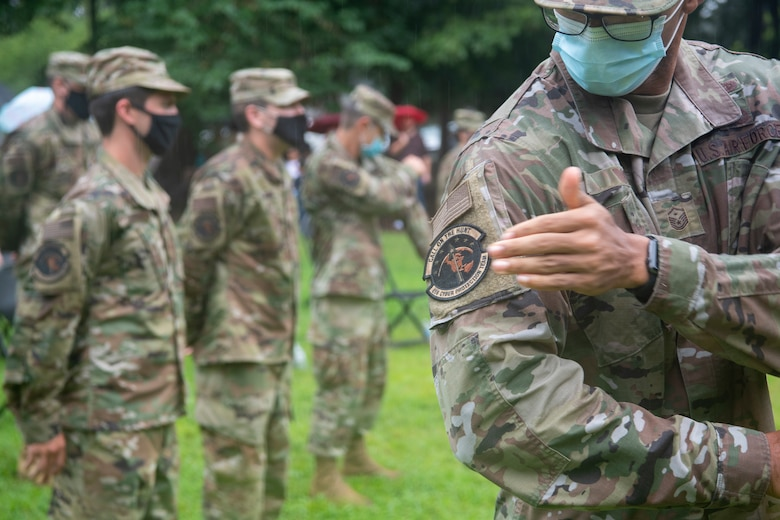 Virginia Air National Guard members from the 185th Cyberspace Operations Squadron ceremoniously removed their 185th COS bat patch, replacing it with the 856th Cyber Protection Team patch during send-off ceremonies Aug. 7, 2021, at Joint Base Langley-Eustis, Virginia.