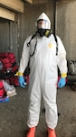 U.S. Army Sgt. Dane Kastl, a member of the urban search and rescue team with the CBRNE (Chemical, Biological, Radiological, Nuclear, and high-yield Explosives) Enhanced Response Force Package, dons a HAZMAT suit to mitigate the spread of COVID-19 while working on Task Force Test Support. More than 250 Colorado National Guard members were mobilized to help the State Emergency Operations Center and the City and County of Denver with COVID-19 response.  Kastl joined the CERFP rescue team in 2014 (Courtesy photo provided by Kastl).