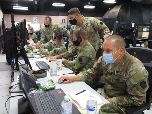 U.S. service members working at computers