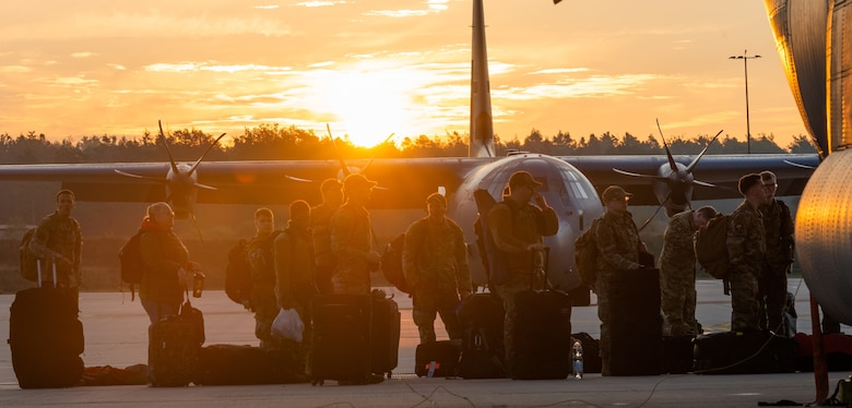 Airmen wait to board an aircraft.