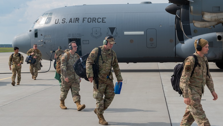 Airmen depart aircraft.