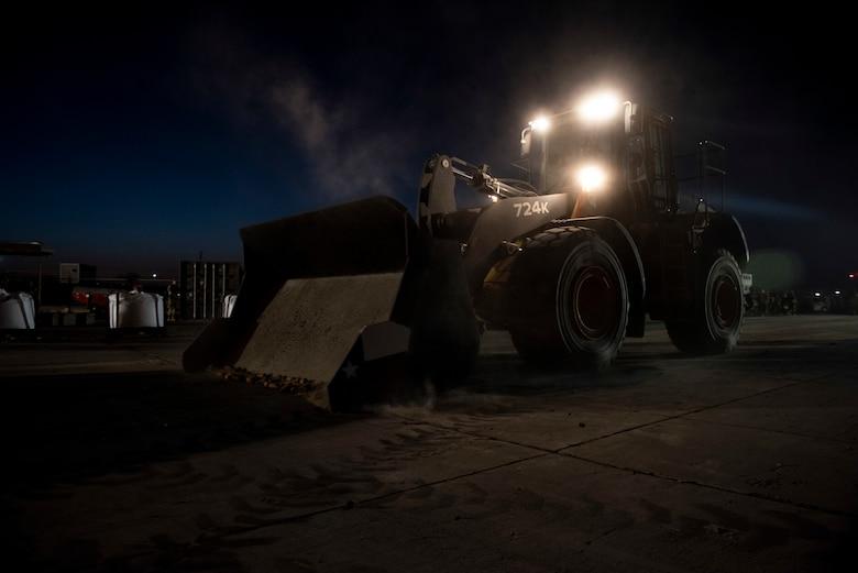 A photo of a bulldozer pushing debris