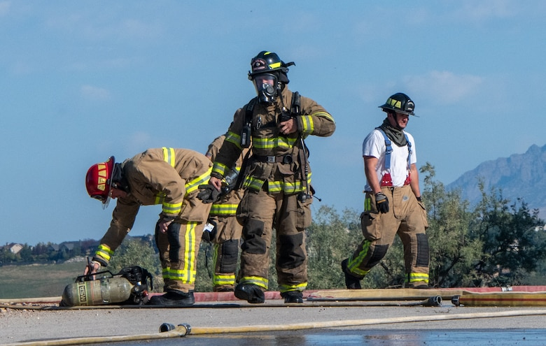 Reserve firefighters from the 419th Civil Engineer Squadron respond to an aircraft live-fire burn at Hill Air Force Base