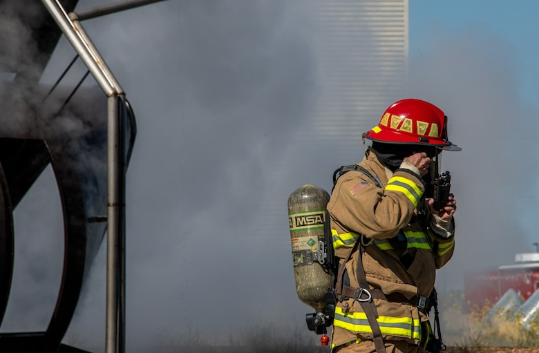 U.S. Air Force Tech. Sgt. Wyatt Matthews, firefighter in the 419th Civil Engineer Squadron, reaches out to fellow firefighters during a readiness training exercise