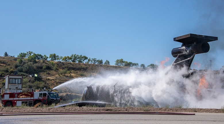Firefighters from the 419th Civil Engineer Squadron extinguish the remnants of a fire during an aircraft live-burn at Hill Air Force Base