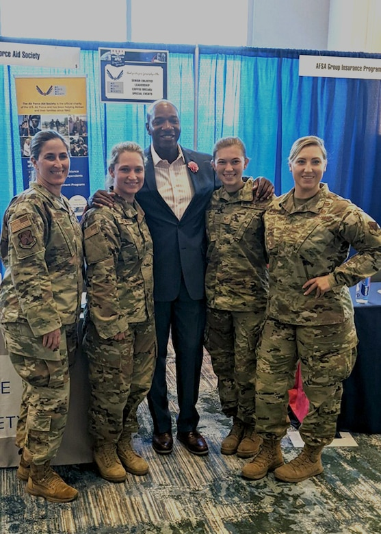 Chief Master Sgt. Laurice Souron, Master Sgt. Jennifer Hartwig, Tech. Sgt. Jaymie White, and Staff Sgt. Sara Kolinski pose for a photo with retired Command Chief Master Sgt. of the Air Force Kaleth O. Wright, 18th CMSAF, at the Air Force Sergeants Association Professional Education and Development Symposium July 26, 2021, in Orlando Florida.  During the symposium the 104th Fighter Wing members met with Air Force senior enlisted leaders and discussed ways that the Air and Space Forces plan to accelerate change.  (U.S. Air National Guard courtesy photo)