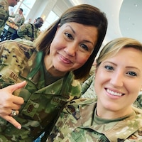 Tech. Sgt. Jaymie White takes a selfie with Command Chief Master Sgt. of the Air Force JoAnne S. Bass, 19th CMSAF, at the Air Force Sergeants Association Professional Education and Development Symposium July 28, 2021, in Orlando Florida.  During the symposium the 104th Fighter Wing members met with Air Force senior enlisted leaders and discussed ways that the Air and Space Forces plan to accelerate change.  (U.S. Air National Guard courtesy photo)