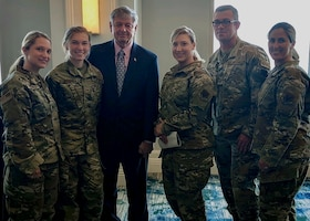 Chief Master Sgt. Laurice Souron, Senior Master Sgt. Jason Ballou, Master Sgt. Jennifer Hartwig, Tech. Sgt. Jaymie White, and Staff Sgt. Sara Kolinski pose for a photo with retired Command Chief Master Sgt. of the Air Force David J. Campanale, 11th CMSAF, at the Air Force Sergeants Association Professional Education and Development Symposium July 26, 2021, in Orlando Florida.  During the symposium the 104th Fighter Wing members met with Air Force senior enlisted leaders and discussed ways that the Air and Space Forces plan to accelerate change.  (U.S. Air National Guard courtesy photo)